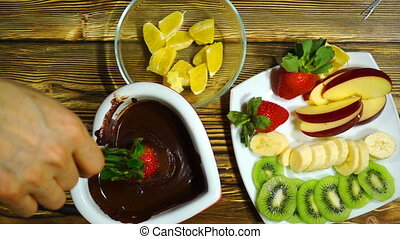 Fondue with chocolate and fruits.