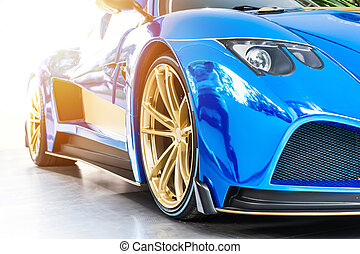Font of a blue sport luxury car in sunset