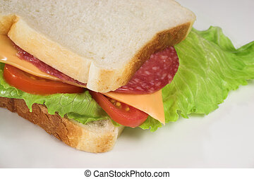Food #21 - A salami, cheese, tomato and lettuce sandwich on...