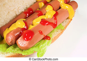 food #23 - A hot dog covered in tomato sauce and mustard on ...