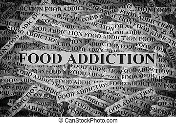 Torn pieces of paper with the words Food Addiction
