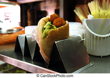 Food and Cuisine - Falafel - Pita with falafel .