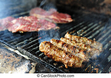 Food and Cuisine - Chef cooks meat on fire.
