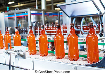 Plastic bottles with beer or carbonated beverage moving on...