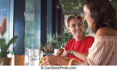 female friends eating at restaurant