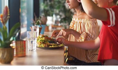 female friends eating at restaurant - food and people...