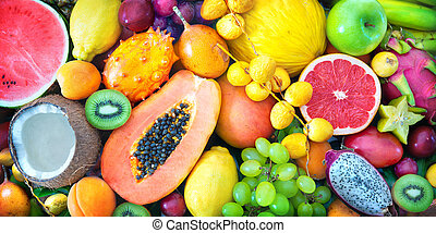 Assortment of colorful ripe tropical fruits. Top view