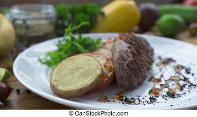 Food background from seasoning and grilled meat steak on wooden table. Food composition in bbq restaurant. Roasted meat with vegetable garnish on wooden background. Healthy diet concept.