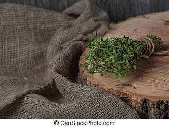 Food background of herb thyme on black kitchen table from above.