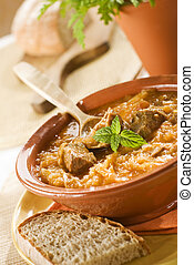 food - beef and cabbage goulash close up shoot