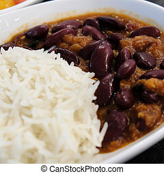 Food. Boiled rice with beans on a white plate