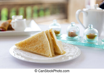 plate with toast bread on table