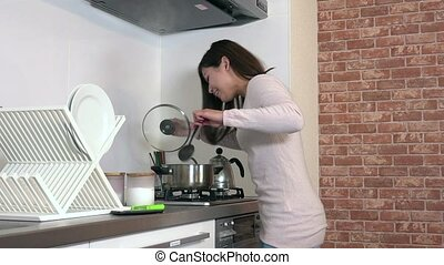 Food Burning On Stove And Woman Running In Home Kitchen
