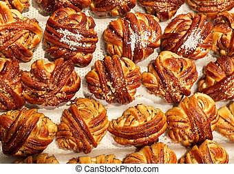 buns or pies at bakery - food, cooking and baking concept - ...