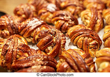 close up of buns or pies at bakery - food, cooking and ...