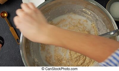 hands making batter with milk at bakery - food cooking, ...
