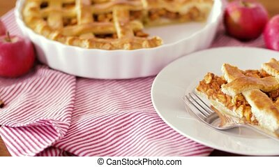 close up of apple pie and fork on plate - food, culinary and...