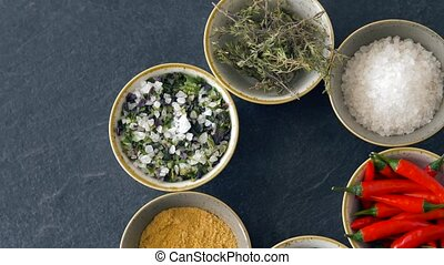 bowls with different spices on wooden table - food, culinary...
