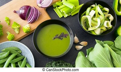 close up of vegetable green cream soup in bowl - food,...