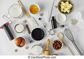 cooking ingredients and kitchen tools for baking