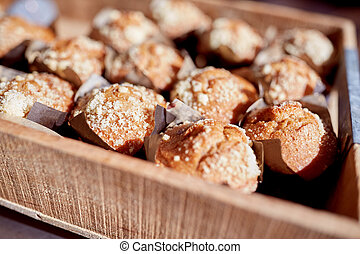 close up of muffins in wooden box
