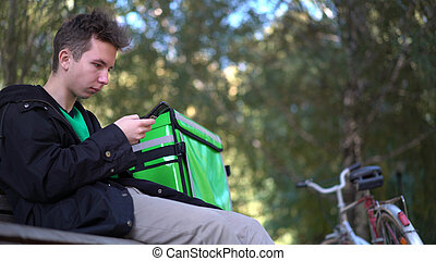 Food Delivery Courier Awaiting Order