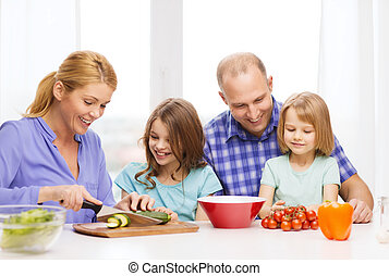 happy family with two kids making dinner at home - food,...