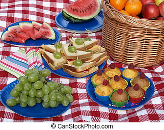 Food for a picnic - Prepared food for picnic, paper dishes,...