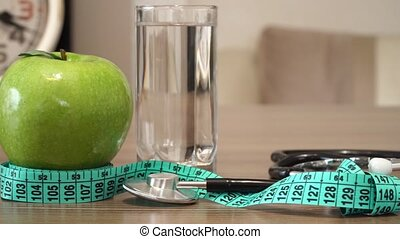 Food for Healthy. Apple, Water and Stethoscope.
