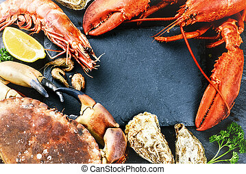 Food frame with crustacean for dinner. Lobster, crab, jumbo shrimps and oysters