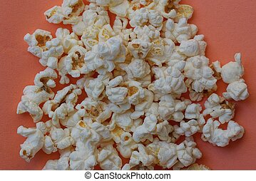 food from a heap of white fried popcorn
