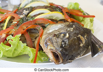 Food from fish. Baked carp. Fish Diet. Fish head on a plate ...