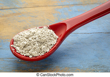 food grade diatomaceous earth detox supplement - red stoneware teaspoon of powder