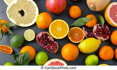 close up of citrus fruits on stone table - food, healthy...