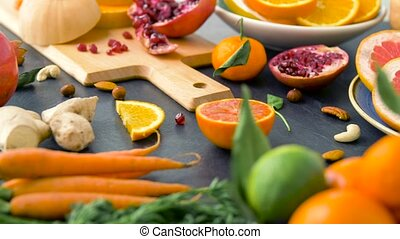 close up of fruits, nuts and vegetables on table