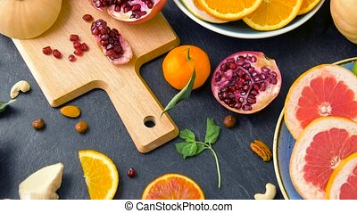 close up of fruits, nuts and vegetables on table - food,...