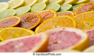 close up of grapefruit, orange, lemon and lime - food,...