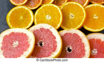 close up of grapefruit, orange, pomelo and lime - food,...