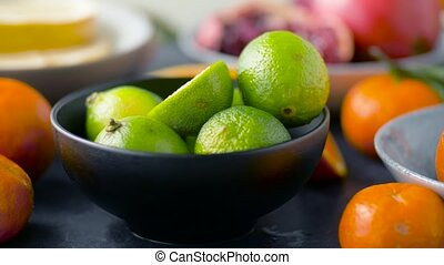 close up of limes, oranges, mandarins and lemons - food,...