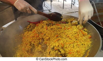 Food hot asia rice - Vender Preparing Pulav on street city