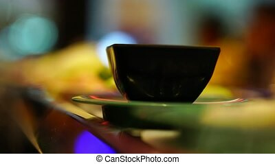 Food in plate rotate on belt movement on bokeh background in...