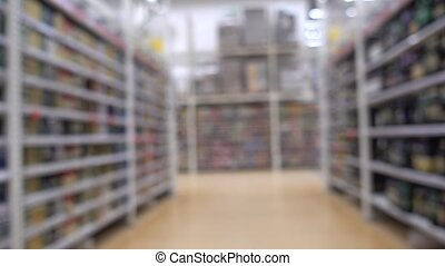 Food in the supermarket of the shopping center. Blurred...