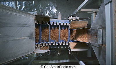 Food industry. Special automatic machine pours on the same...
