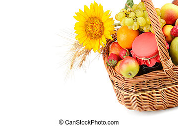 Food isolated on white background. A set of fruits in a woven basket. Free space for text.
