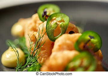 close up of king prawns with jalapeno