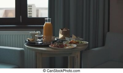 Food on a table in a hotel room. Breakfast in a hotel room.
