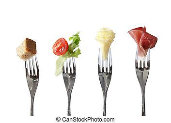Food on forks: bread, vegetable, cheese and meat - four...