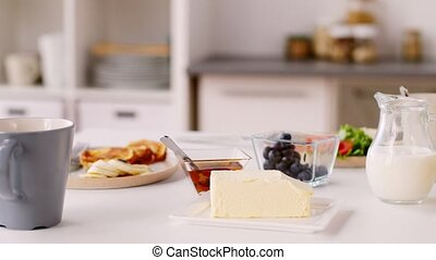 food or home breakfast on table - food and eating concept -...