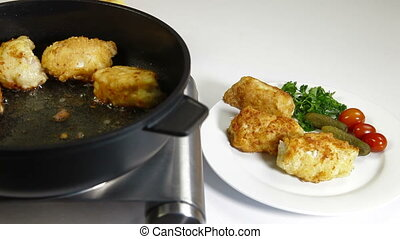 frying chicken breast roll on a pan.