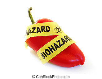 Red pepper with bio-hazard tape. food safety concept